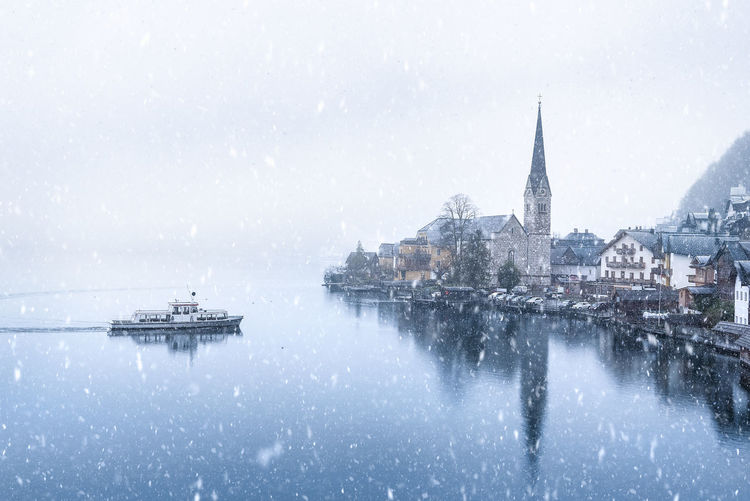 Church By Sea Against Sky During Snowfall