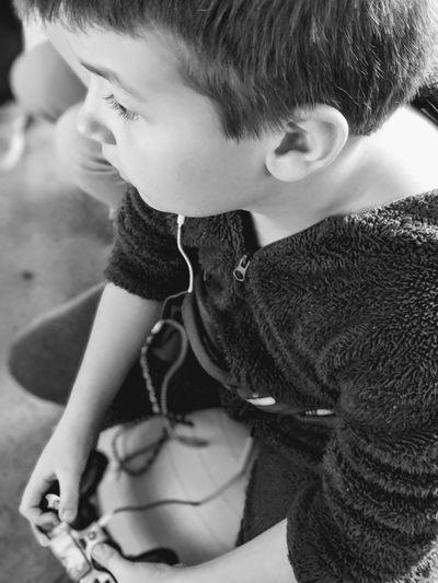 gamer boy on exercise ball Boy Gaming Childhood Play Child Childhood Portrait Headshot Close-up