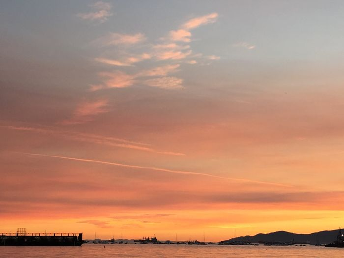 Low angle view of orange sky at english bay