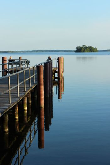 Calm Leading Outdoors Pier Railing Reflection Tranquil Scene Water Waterfront