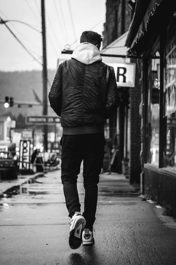 Senior shoot Rear View Full Length One Person Street City Built Structure People Adult Building Exterior Adults Only Outdoors Day Architecture One Man Only Warm Clothing Men Real People Only Men Young Adult Young Men City Fashion Photography Lifestyles Fashion One Young Man Only