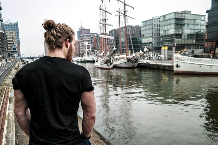 Only Men One Man Only One Person City Harbor Nautical Vessel Adults Only Water Rear View Outdoors Architecture Men Adult Building Exterior Day People Cityscape Young Adult