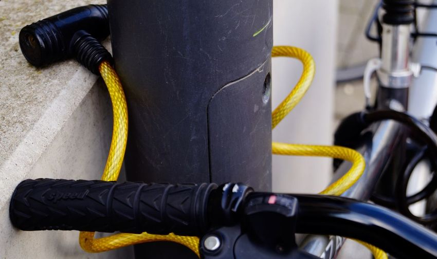 Close-up of yellow bicycle