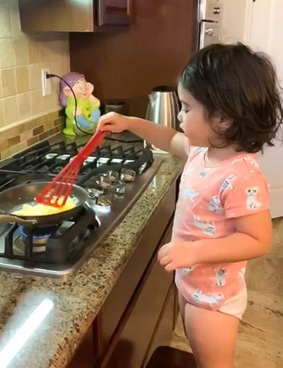 Home Domestic Kitchen Kitchen Domestic Room Lifestyles My Best Photo Indoors  Childhood Standing Real People Domestic Life One Person Girls Household Equipment Females Child Holding Kitchen Utensil Stove Hairstyle