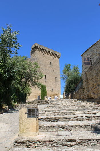 Castle Provence Provence Alpes Cote D´Azur Ancient Ancient Civilization Architecture Building Building Exterior Built Structure Chateauneufdupape Clear Sky History Old Old Castle Plant Sky Staircase Sunlight The Past Tower Travel Destinations Tree Upward Perspective Upward View Upwards