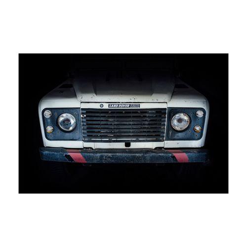 Close-up of vintage car on black background