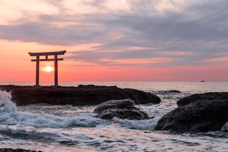 Torii Gate At Beach During Sunset