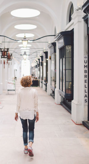 Blonde Blue Jeans Casual Clothing Curly Hair Full Length Gallery Girl Incidental People Rear View Standing The Royal Opera Arcade White Shirt People And Places London Lifestyle