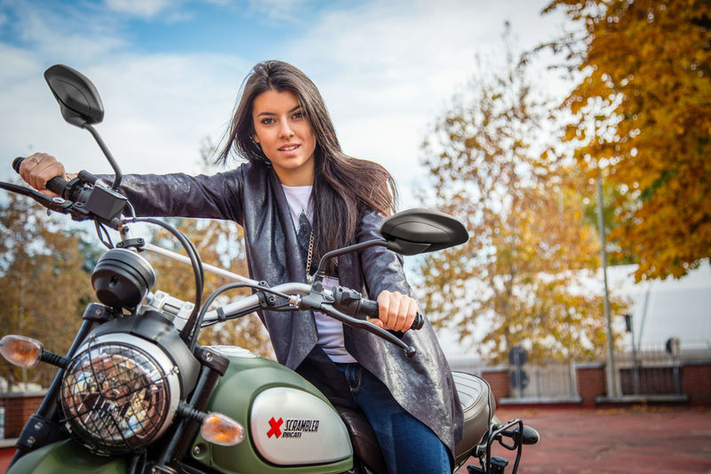 Young woman on a Ducati Scrambler Beautiful Woman Biker Ducati Lady Biker Motorcycle One Person Outdoors Scrambler Sky Young Adult Young Woman