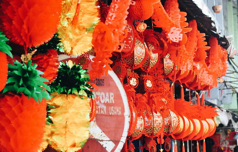 Close-up of red flowers hanging in market