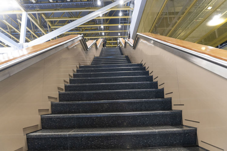 Staircase Architecture Steps And Staircases Railing Built Structure Indoors  Direction The Way Forward No People Illuminated Low Angle View Building Transportation Metal Convenience Absence Day Empty Ceiling