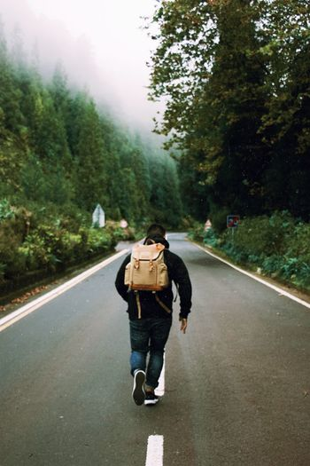Never stop exploring Outdoors Adventure Travel Destinations Road One Person Tree Full Length Real People Plant Transportation Street Walking City Nature Leisure Activity Lifestyles Day The Way Forward Rear View Casual Clothing Motion Outdoors Warm Clothing Autumn Mood Autumn Mood Autumn Mood