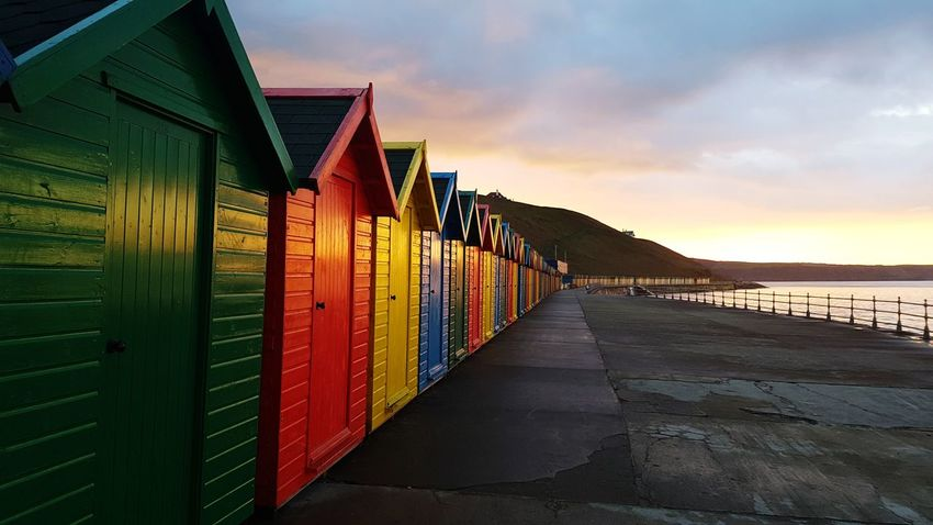 Sunset No People Green Color Cloud - Sky Beach Sky Outdoors Multi Colored Water Day Nightphotography Beach Huts Beach Huts And Evening Sky Colourful Red Green Blue Yellow Night Sky Whitby Whitby Beach Sea Whitby North Yorkshire