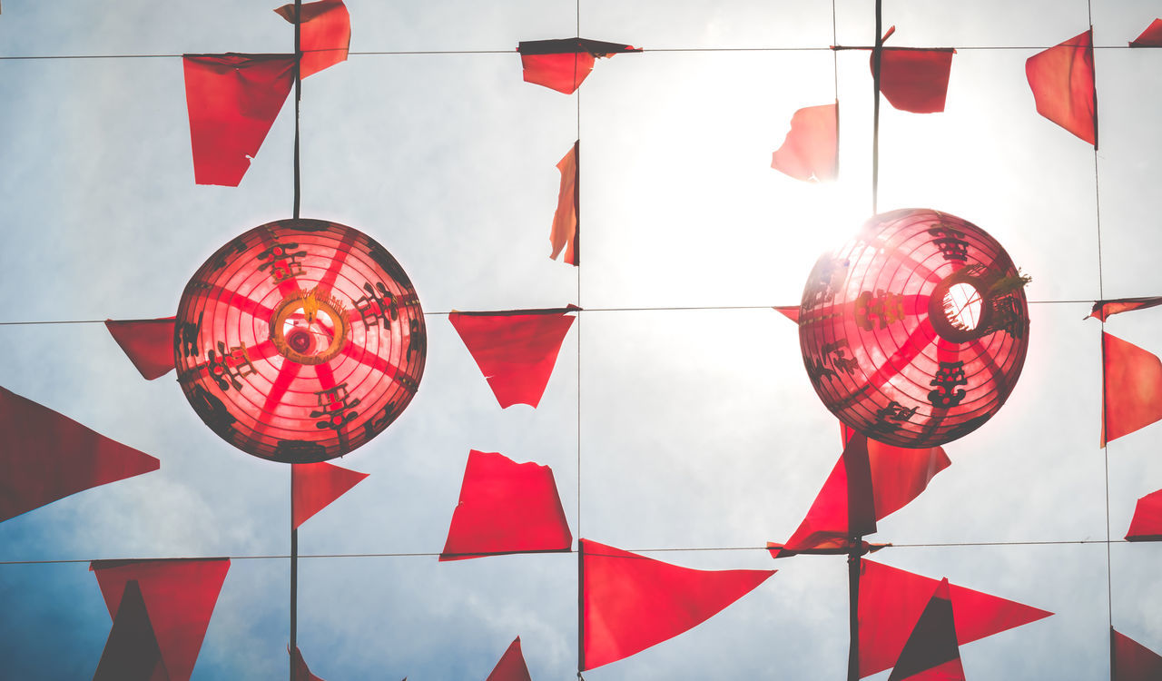 Directly below shot of chinese lanterns with decorations against sky