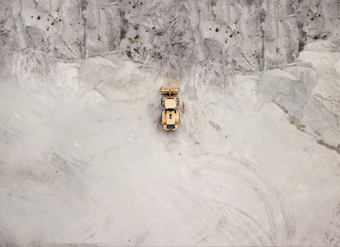 Bulldozer Car Construction Industry Day High Angle View Industry Land Land Vehicle Mode Of Transportation Motor Vehicle Nature No People Outdoors Rock Small Snow Toy Transportation Winter