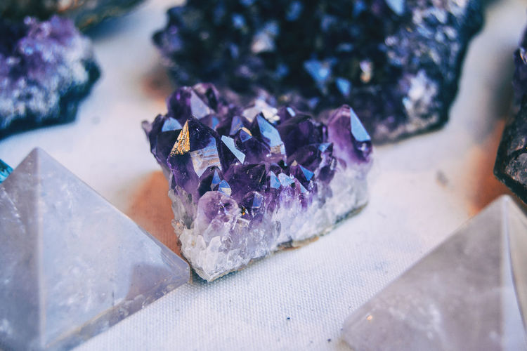 Beauty In Nature Close-up Crystal Flower Focus On Foreground Freshness Gemstone  Geology Indoors  Jewelry Mineral Nature No People Paper Precious Gem Purple Quartz Rock - Object Selective Focus Semi-precious Gem Solid Still Life