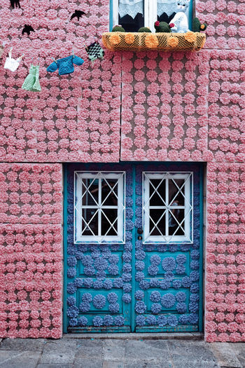 WOOL POWER Threeweeksgalicia Architecture No People Pink Color Wool Wool Balls Wooly Built Structure Building Exterior Door Entrance Building Closed Day House Window Wall Wall - Building Feature Security Protection Outdoors Residential District Multi Colored Safety Brick