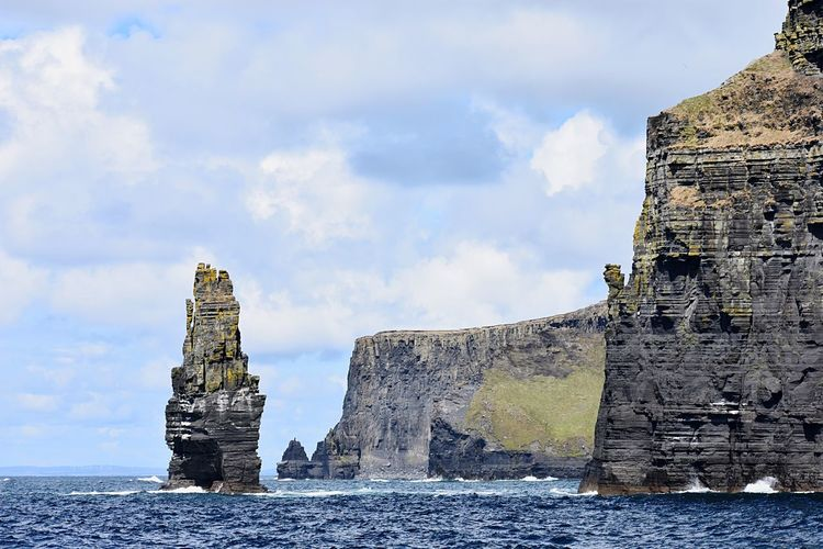 Cliffs of Mohr, Dumbledore Rock Outdoors Scenics - Nature Tall Stone Rock Formation Ireland Cliffs Cliff Dumbledore Harry Potter Ferry Water Sky Cloud - Sky Nature Day No People Low Angle View The Past History Solid Rock Old Sunlight