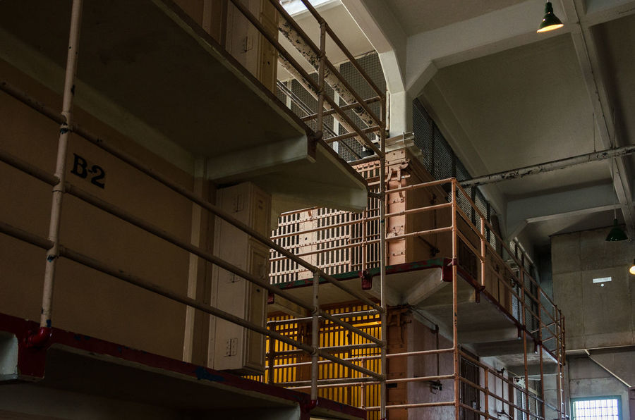 Prison Alcatraz Alcatraz Island Prison Building Metal Built Structure Indoors  Architecture Day Cage Prison Bars Prison Cell Ceiling No People Low Angle View Punishment Abandoned Domestic Room The Past Bed Illuminated
