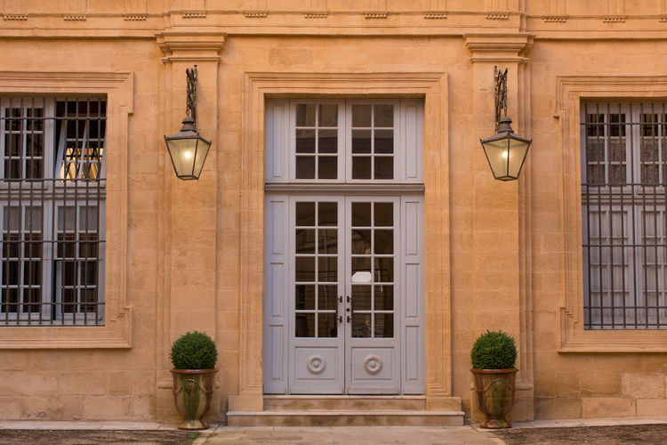 Entrance of an old building in the old city at Aix-en-Provence Arch Architecture Building Exterior Built Structure Closed Door Day Electric Light Exterior Façade Footpath History Lamp Post Old City Outdoors Street Light Window