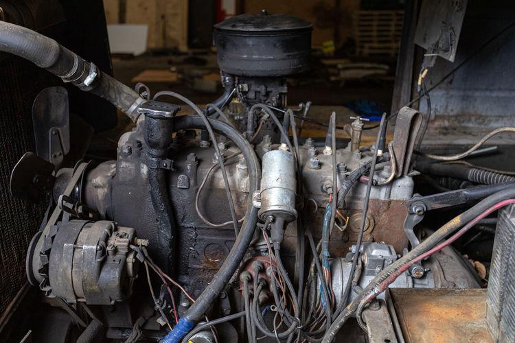 Close-up of car engine in garage