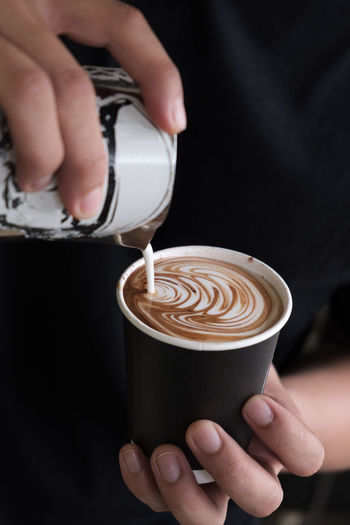 Coffee Coffee - Drink Human Hand Coffee Cup Food And Drink Cup Drink Hand Holding Mug Refreshment One Person Real People Frothy Drink Cappuccino Human Body Part Froth Art Indoors  Hot Drink Barista Latte Finger Preparation