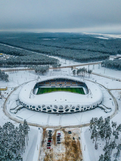 Borisov Arena football stadium, Belarus Architecture Built Structure High Angle View Plant Day Nature No People Road Tree Transportation Mode Of Transportation Sky Car Connection Winter Snow Outdoors Stadium Soccer Football Borisov Arena Aerial View