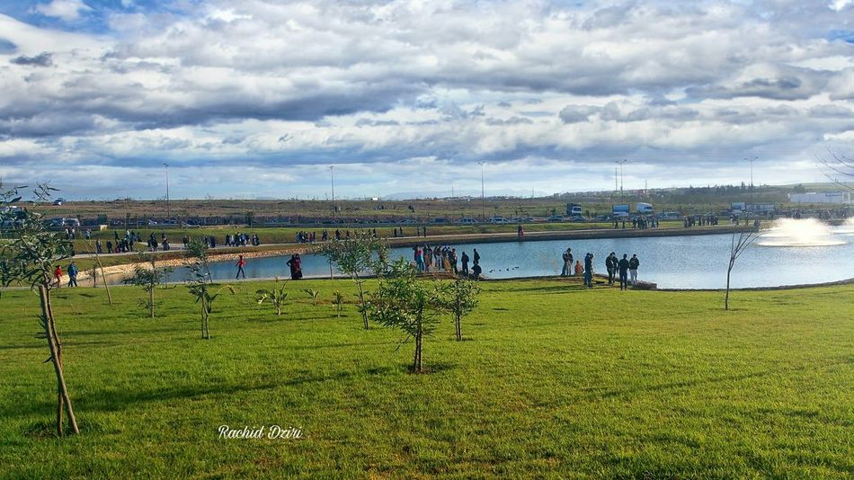 Sky Cloud - Sky Nature Growth Grass Green Color Large Group Of People People Water Beauty In Nature Morocco Beauty Morocco 🇲🇦 Oujda Tourism Tranquility Quiet Beauty Quietude Freshness Green Color Beauty In Nature Growth Travel Garden Publicgarden