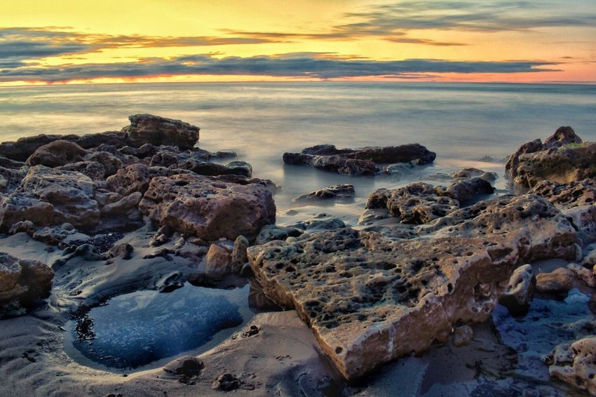 Sunset Sky Nature Scenics Rock - Object Tranquil Scene Beauty In Nature Tranquility Water Sea No People Cloud - Sky Outdoors Landscape Beach Horizon Over Water Day