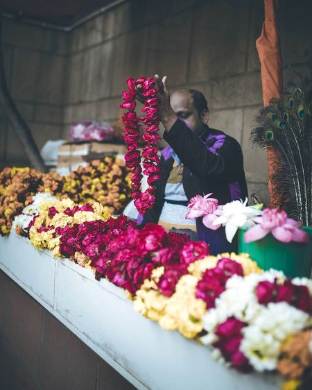 Vendor Selling Floral Garlands At Shop