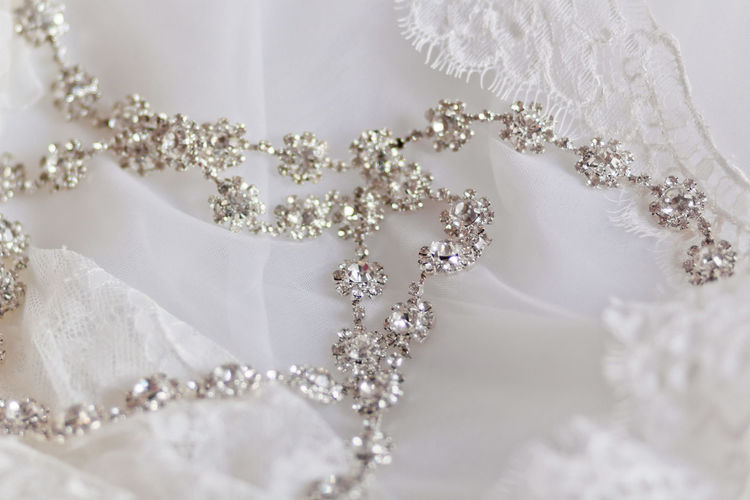 Close-up of necklace on wedding dress