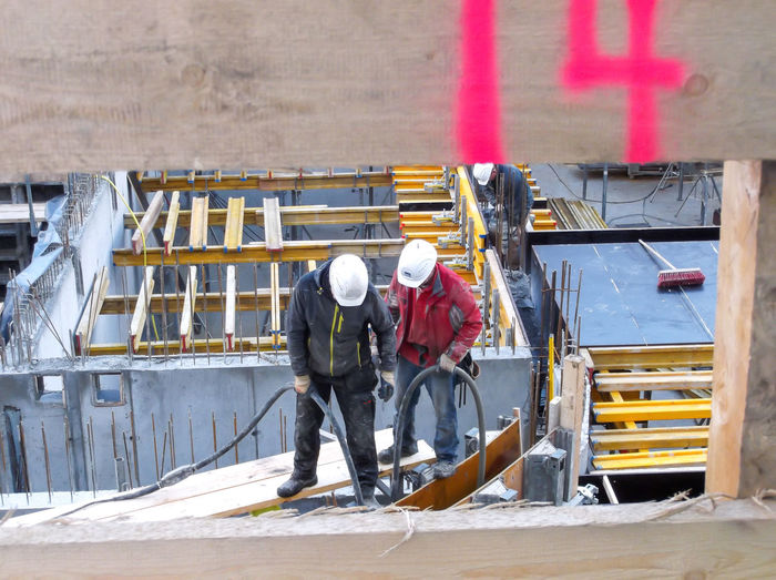 Men working at construction site during winter