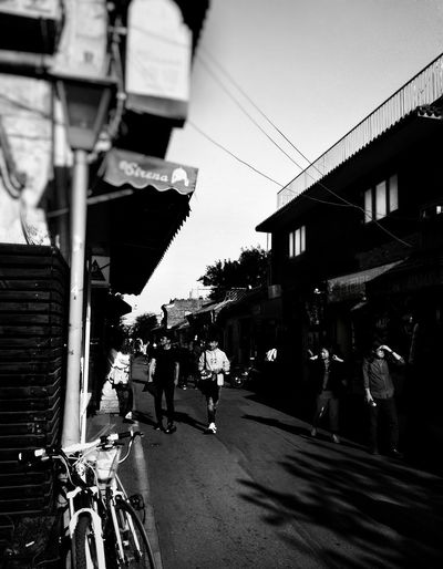 City walk Hutong b&w street photography People Hutong Life Citylife Lifestyles City Men Street Architecture Building Exterior Sky Zebra Crossing Road Marking Moving Pedestrian Bicycle Lane Pedestrian Crossing Sign