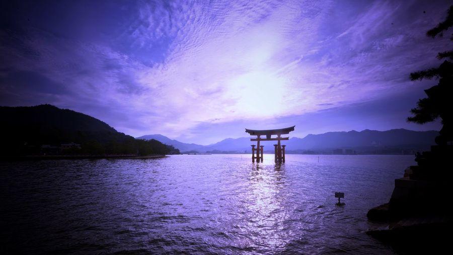 Miyajima EyeEm Gallery Gate Spiritual Place Japan Photography Miyajima Water Sky Beauty In Nature Scenics - Nature Cloud - Sky Nature Reflection Tranquility Tranquil Scene Sea Waterfront No People Idyllic Purple