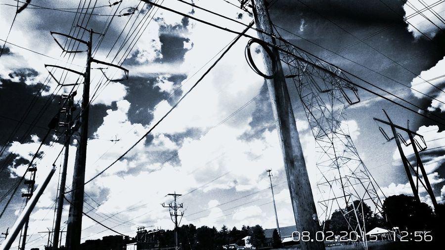 This was taken on our little road trip Sunday. It was taken from the vehicle while traveling at 35 - 40mph Outdoors Beauty In Hidden Places EyeEm Gallery Transformers Wires Sunny Day Fluffy Clouds Towers Power Lines Taking Photos People And Places Eyeem Market Monochrome Photography TakeoverContrast Eye4photography  EyeEm Masterclass