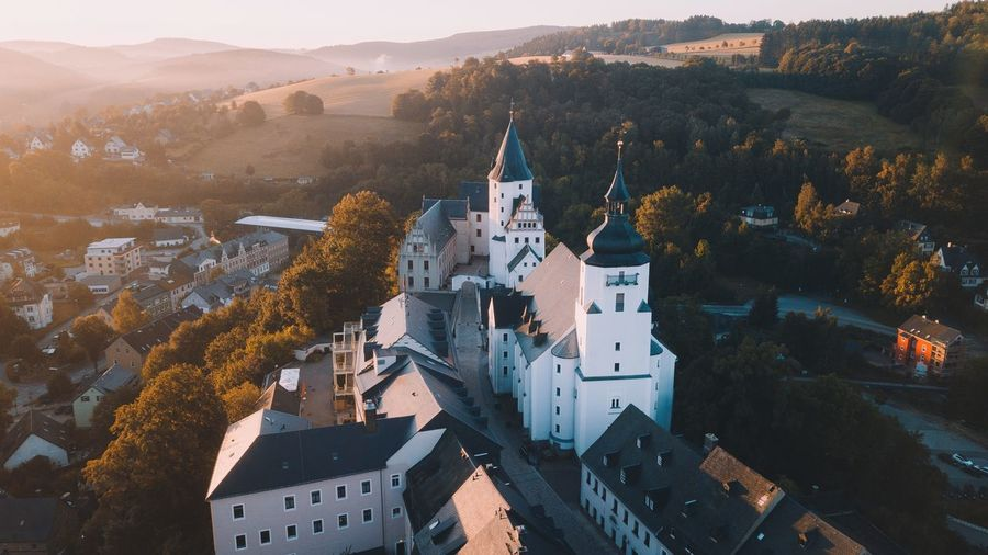 Sunrise in the Ore Mountains Germany Ore Mountains Building Exterior Architecture Building Built Structure City Nature High Angle View No People Autumn Plant Residential District Sunlight Cityscape Mountain Tree Outdoors Day Religion Travel Destinations