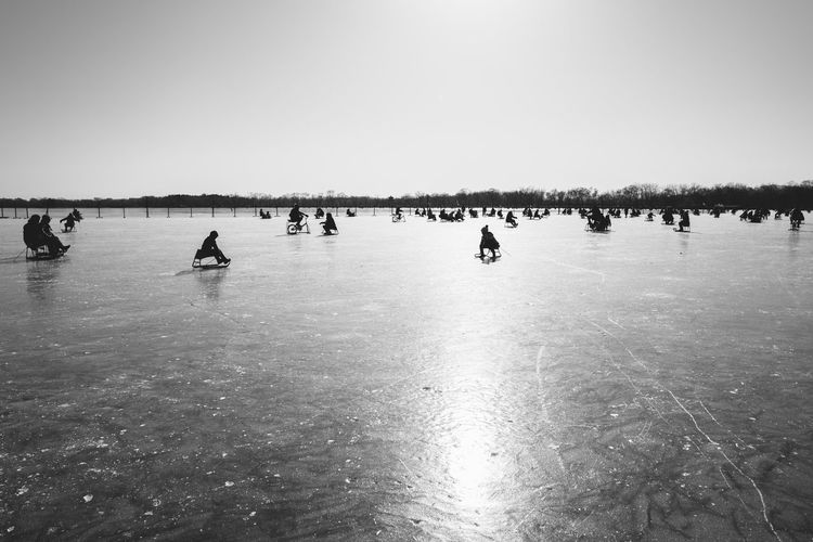 Ice skating on the ice lake Beach Beauty In Nature Clear Sky Day Ice Ice Skating Lake Nature Outdoors People Sea Silhouette Sky Water