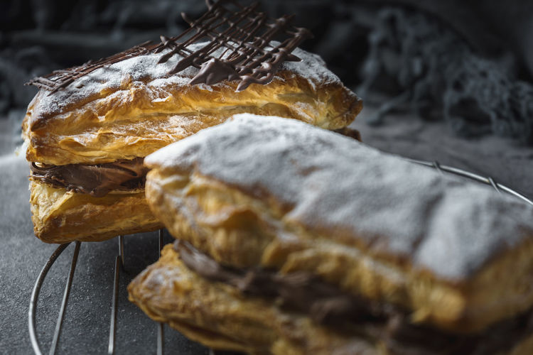 Puff pastry with confectioner's sugar and chocolate filling