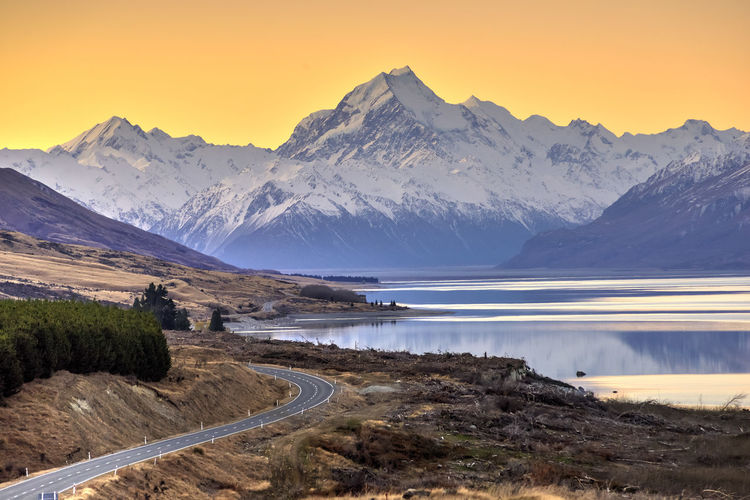 Road To Aoraki Mount Cook. Mount Cook National Park, New Zealand Beauty In Nature Idyllic Lake Landscape Mountain Mountain Peak Mountain Range Nature Night No People Outdoors Reflection Scenics Sky Snow Sunset Travel Vacations Water