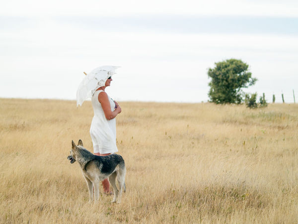 Countryside Dehesa Dog Dog And Woman Dry Grass Field Grassland Meadow Model Modeling Nature Nature One Person One Woman Only Outdoors Parasol Pasture, Paddock, Grassland, Pastureland Pet Real People Summer Summertime Umbrella Woman Woman And Dog Woman Portrait