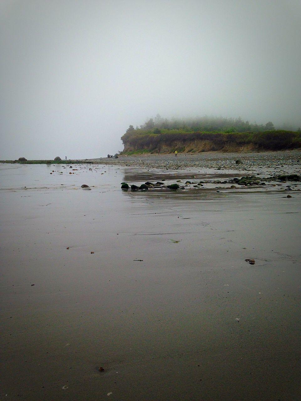 Beach Against Sky During Foggy Weather