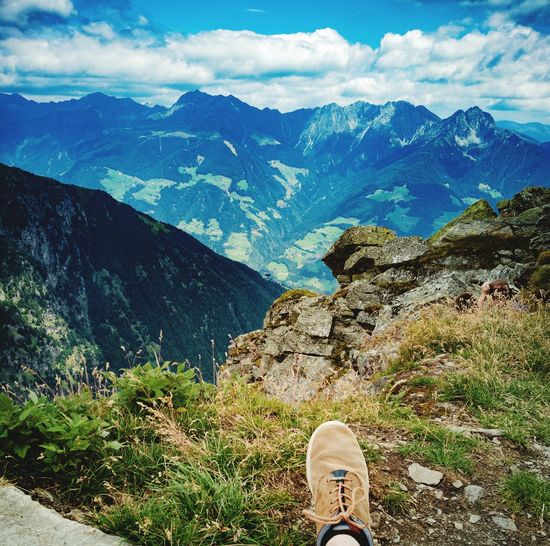 After hiking on a mountain Nature Cloud Traveling Travel EyeEm Selects Panorma Mountains Mountain Hikingadventures Hiking Youth Italy Dorftirol Low Section Shoe Human Leg High Angle View Water First Eyeem Photo EyeEmNewHere Calm Hiker Cliff Rock Formation