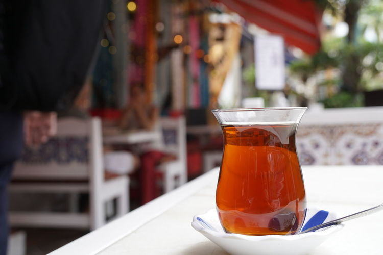 Close-up of tea in glass on table at restaurant
