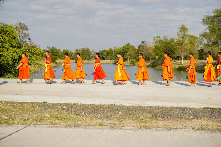 Monks walking on footpath
