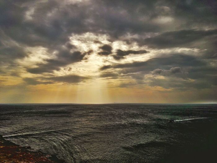 Sea Sunset Beach Water Horizon Over Water Cloud - Sky Dramatic Sky Nature Scenics Tranquility Beauty In Nature Sky Tranquil Scene Outdoors No People Sunlight Travel Destinations Sun Awe Sand