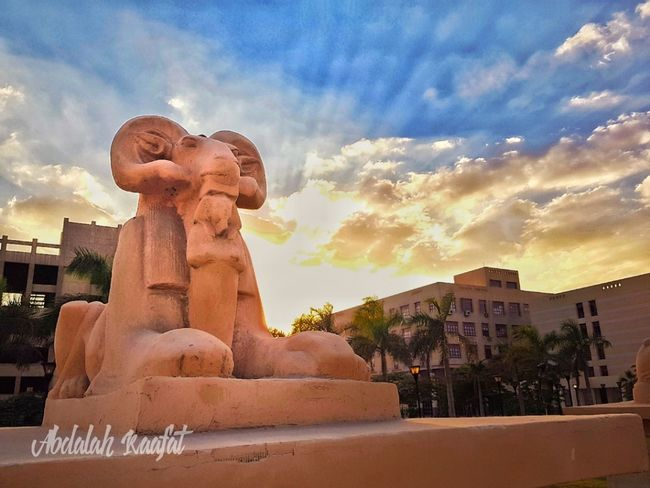 Statue Sculpture Architecture Cloud - Sky Religion Travel Destinations Sky Business Finance And Industry Built Structure No People Outdoors Sunset Building Exterior Egypt Egyptdailylife Egyptphotography Day Nature
