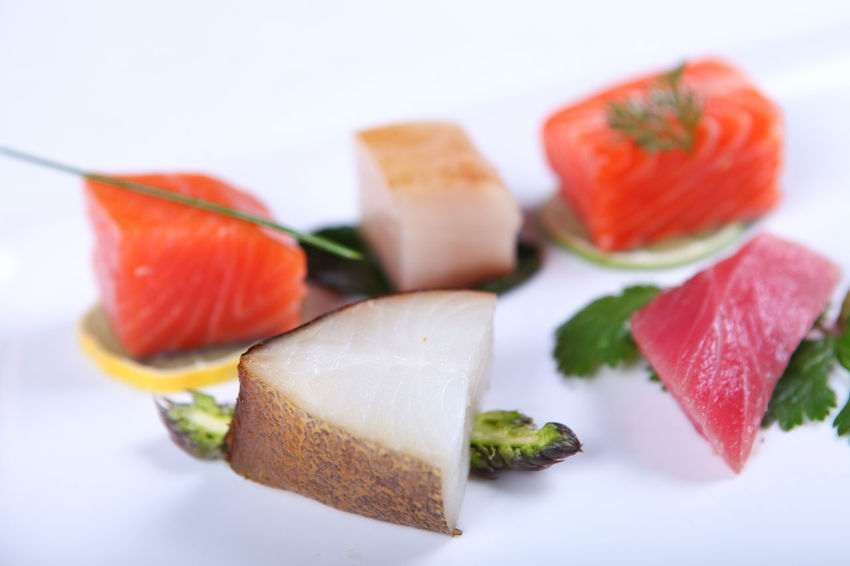 Fresh sashimi decorated with greens and lime. Close-up Close-up Decorated Dish Fish Food Food And Drink Freshness Healthy Eating No People Plate Ready-to-eat Salmon Sashimi  Seacreatures Seafood SLICE Sushi White Background
