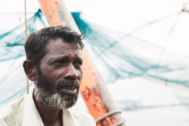 Close-up of fisherman looking away