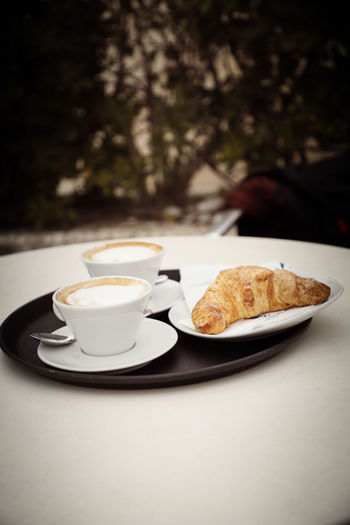 Breakfast Croissant Cappuccino Cappucino Italy Coffee Coffee - Drink Coffee Cup Coffee Time Hot Drink Crema Onthetable Food And Drink Mug Table Drink Cup Food Plate Refreshment Freshness Crockery Baked Indoors  Ready-to-eat French Food Meal Snack Sitting Outside