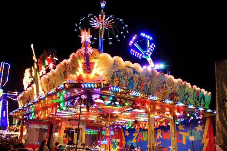 WUMA 2018 WUMA Wurstmarkt Weinfest Carousel Illuminated City Multi Colored Amusement Park Ride Arts Culture And Entertainment Amusement Park Celebration Holiday - Event